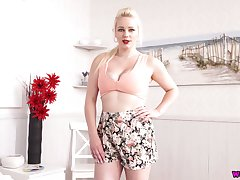 Juggy blond milf Megan gets naked and shows off her engrossing assets