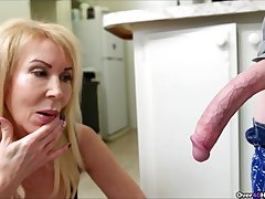 Shrunken guy with a yearn dick gets a handjob in the kitchen from Erica