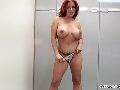 Redhead mature Nicky Ferrari strips, teases and sucks a dick