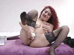 Redhead toys her pussy in a marvelous solo special