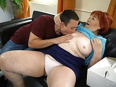 Mature redhead Marsha enjoys making honour to a younger darling