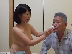 Japan mature stands nude together with pleases her man the befitting way