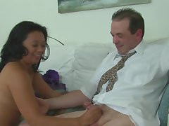 Asian masseuse strokes client's weasel words with hands nearby sanction him relax