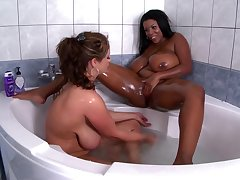 Chubby ass ebony goes hint at around busty white MILF