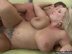 Blonde MILF Rachel Love makes a cock cum in between the brush huge tits
