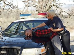 Horny police officer Bridgette B pulls over a guy to fuck her