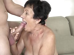 Brunette granny enjoys sexual relations with young neighbor